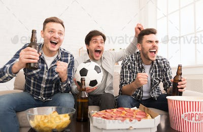 Goal. Happy men watching football match at home