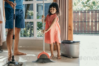 father and daughter clean up the house