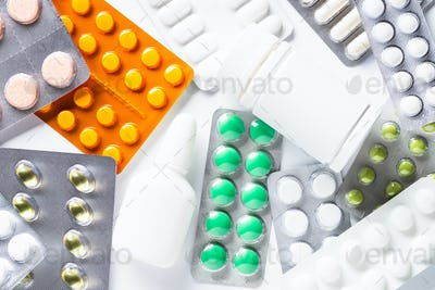 Pills in a blister on white top view
