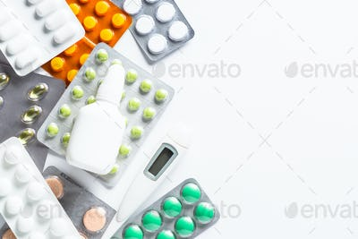 Tablets and medicines on a white top view