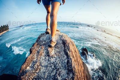 walking at seaside cliff edge
