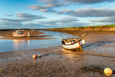 Boats on the river estuary at Burnham Overy Staithe