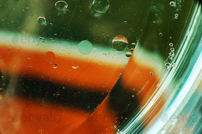 A beautiful and colorful macro of oil bubbles on water with a wh