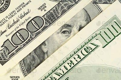 Benjamin Franklin portrait at hundred dollar bills.