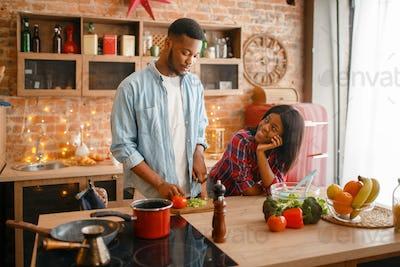 Black love couple cooking romantic dinner