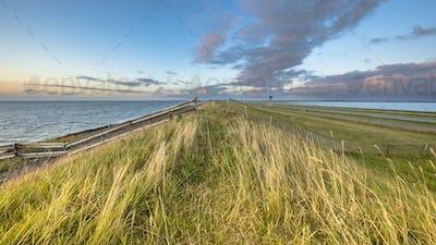 Afsluitdijk dutch dike sunset fence