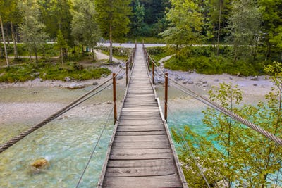 Swingbridge over blue Soca river near Bovec