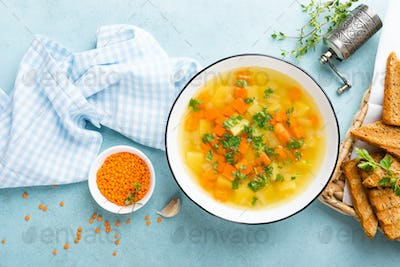 Lentil soup with vegetables and fresh parsley on plate