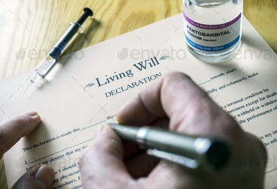 Living will declaration form Next to a vial of pentobarbital sodium