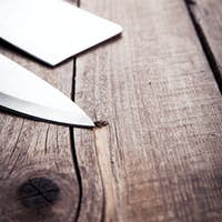 Beautiful knives with wooden handle, on an old table. Kitchen, cooking, cutting