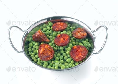 boiled peas in metal bowl isolated on white background
