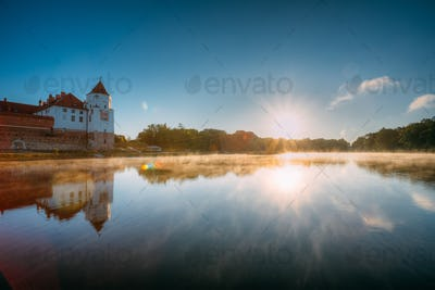 Mir, Belarus. Scenic View Of Castle Complex Mir And Lake In Mist