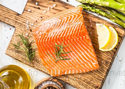 Salmon fillet with ingredients for cooking - fresh vegetables a