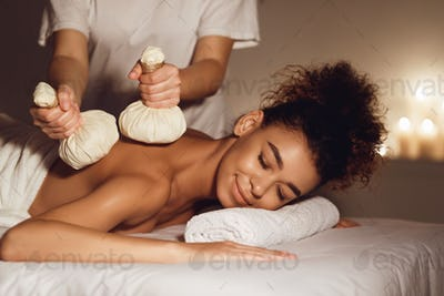 Body care. Massage with hot herbal balls for deep relaxation