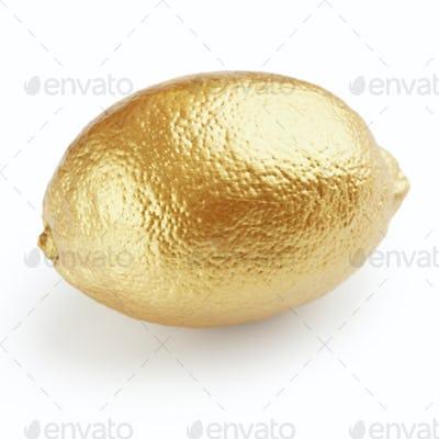 Golden lemon on white