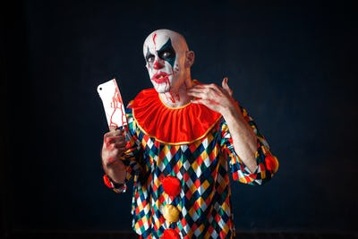 Mad bloody clown with meat cleaver, circus horror