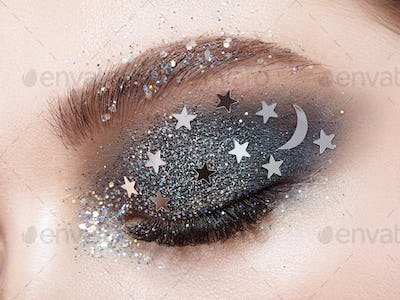 Eye makeup woman with decorative stars