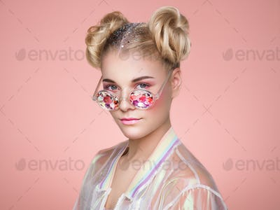 Blonde young woman in holographic jacket