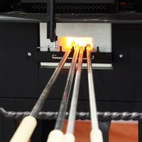 Glass blower tubes in the furnace