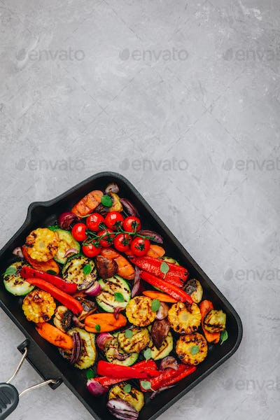 Grilled vegetables in a cast iron pan. Top view.