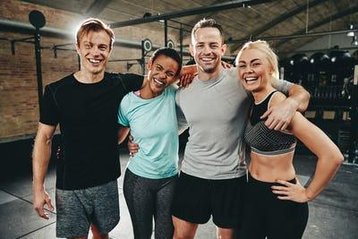Diverse friends laughing after a workout at the gym