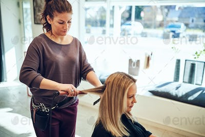 Woman sitting in a salon chair having her hair styled