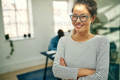 Young Asian businesswoman smiling while working in a modern office