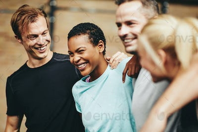 Diverse friends laughing after working out at the gym