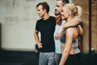 Diverse group of friends smiling together after a gym workout