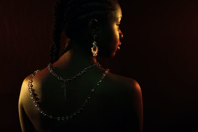 Colorful and creative portrait of african womans back with dark skin