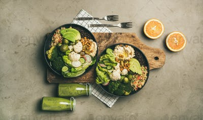 Flat-lay of healthy lunch setting with superbowls and smoothies
