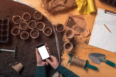 Smartphone mock up in hands of organic gardener