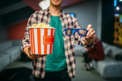 Male spectator with 3d glasses and popcorn, cinema