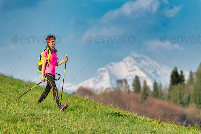 Young woman returning from a Nordic walking excursion