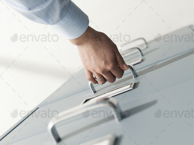 Secretary searching files in the filing cabinet