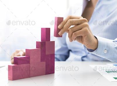 Businesswoman building a growing financial chart