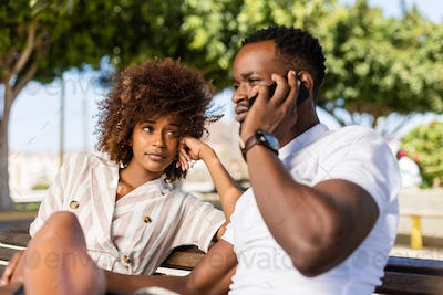 Outdoor protrait of black african american couple -  Girl bored