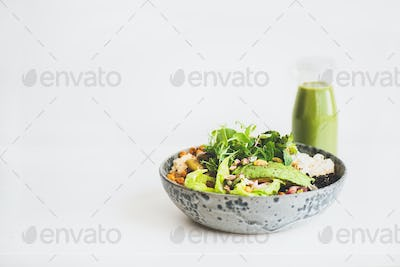 Healthy vegan superbowl with hummus and green smoothie