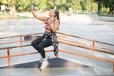 Young pretty smiling plus size woman in pink sporty top,leggings