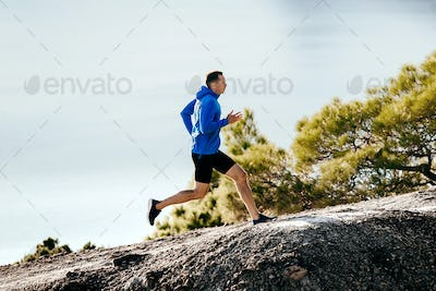 man runner in blue jacket