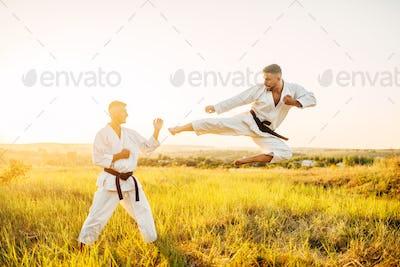 Karate fighters, kick in flight on training fight