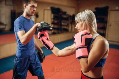Female kickboxer practicing hand punch