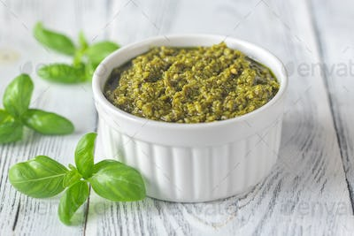 Bowl of pesto on the wooden table
