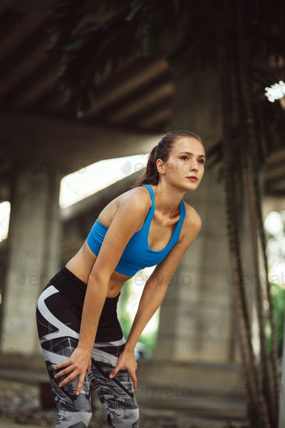 young adult sporty girl workout outdoor on urban streets