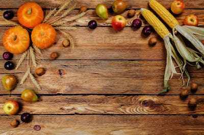 Autumn vegetable and fruit wood background