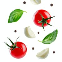Flying tomatoes with Basil leaves, garlics and peppers
