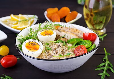 reakfast bowl with oatmeal, chicken fillet, tomato, lettuce, microgreens