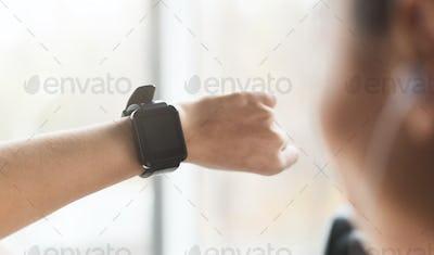 Girl using sport smart watch, doing cardio exercise