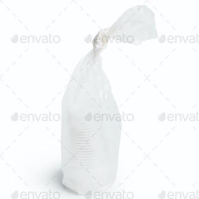 Tied plastic bag on white