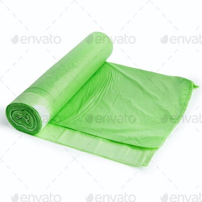 Green plastic bags on white